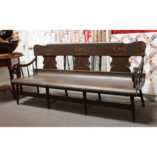This large and deep 19th century original painted and decorated settle bench is made in New Berlin, Pennsylvania. It is in...