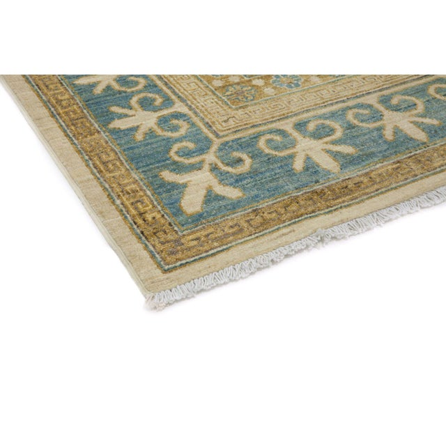 Originating in the ancient trading city of Khotan, traditional Khotan rugs beautifully balance styles from different...