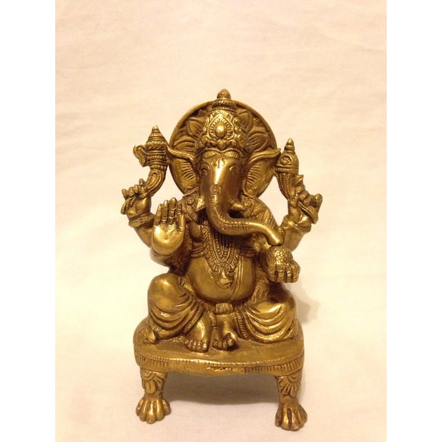 A vintage brass figure of the Hindu god of happiness, Ganesha.