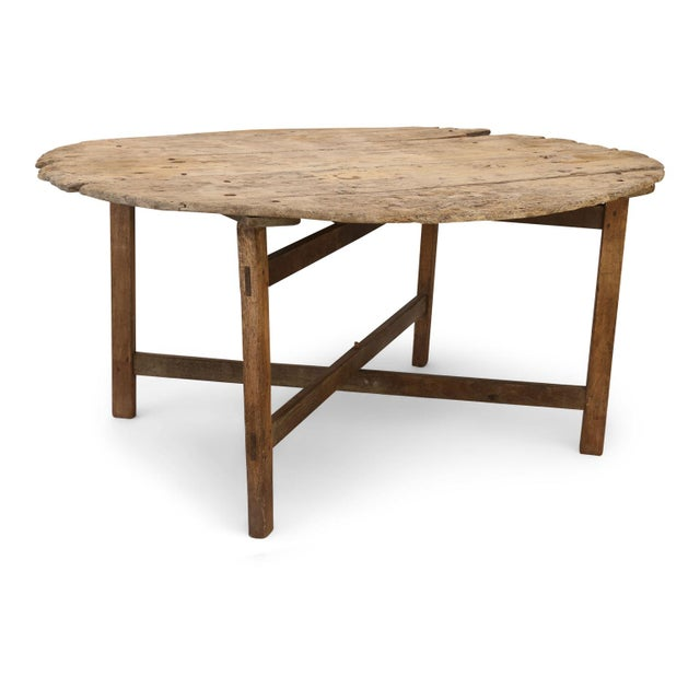 Unusually large early vendange table dating to early 19th century, France. Understated simple lines and an exquisite...
