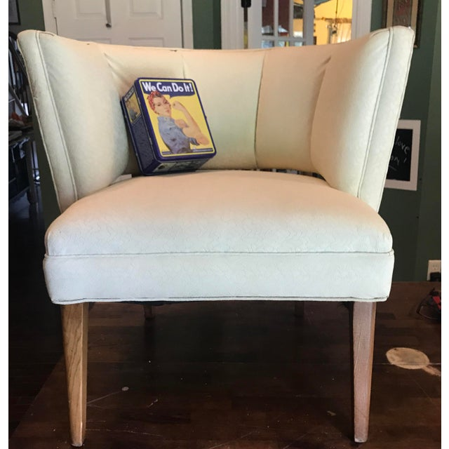 "This 1950's club/slipper chair boasts the original vinyl upholstery in a creamy white. (""To keep it neat and clean""..."