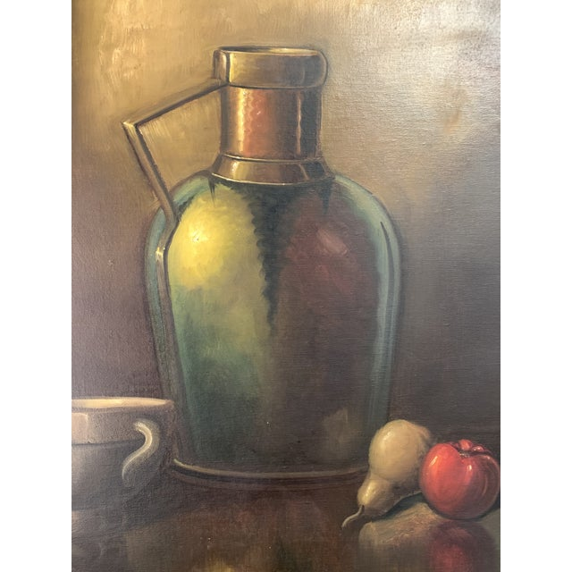 Warm still life painting in a gold wood frame. Signed by artist.