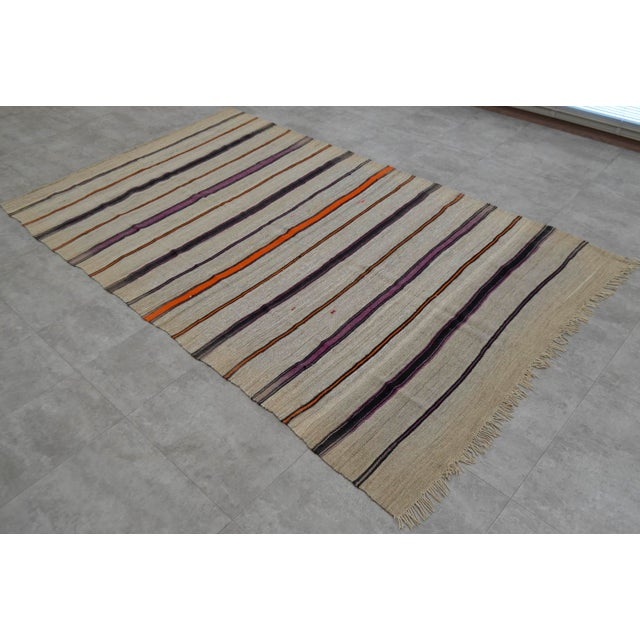 Gray natural background purple and black striped kilim rug, from Aegean Turkey. In excellent condition. Approximately...
