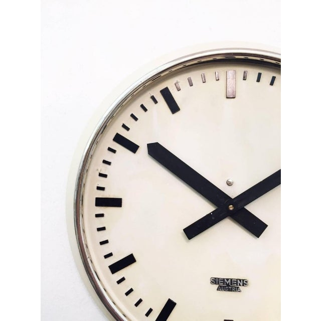 This steel painted clock with glass was made in Germany in the 1950s. Formerly a slave clock, it is now fitted with a...