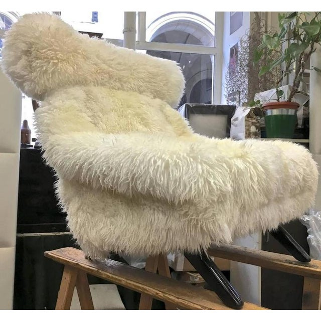 Illum Wikkelso spectacular hammer lounge chair covered in natural sheepskin fur with great comfort.