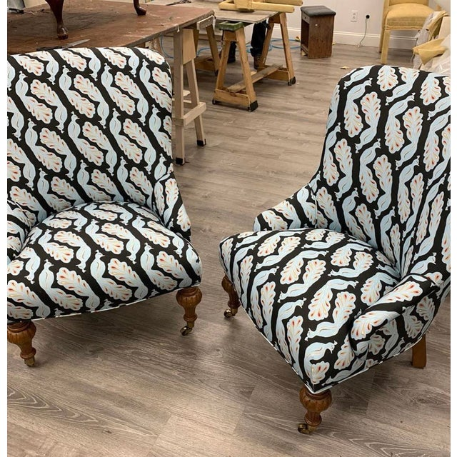 These vintage chairs were given new live upholstered in Bradley USA peacock fabric. They are a modern update on a classic...