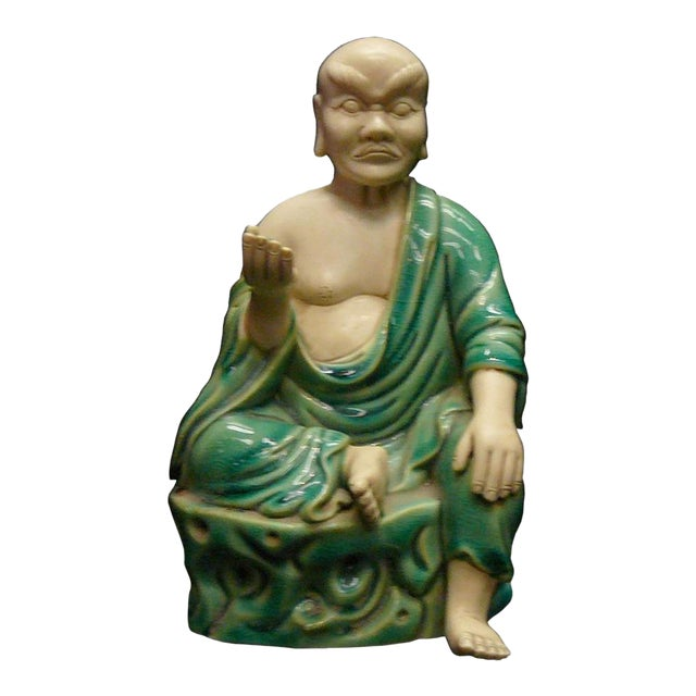 Chinese Handmade Green Ceramic Lo Hon Holding a Bead Seating Statue For Sale