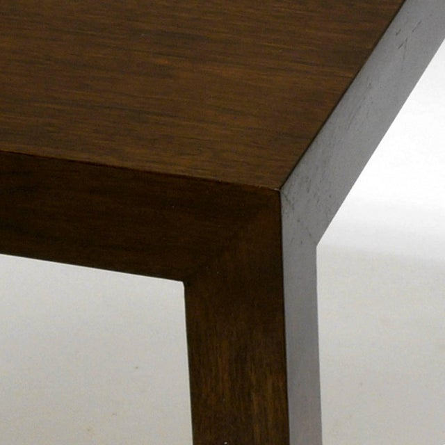 Beautiful pair of Dunbar Parsons tables designed by Ed Wormley. Both tables retain the original Dunbar badge on the...