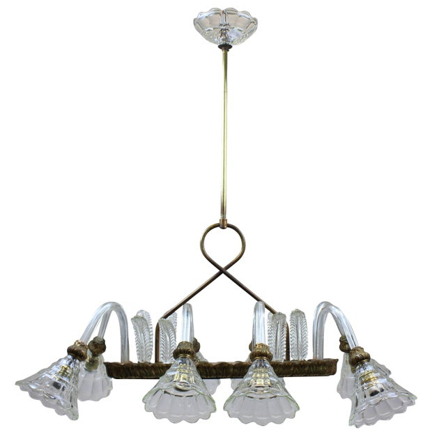 An eight-arm Barovier light of rectangular design. With handblown leaves, arms and cups and brass fittings.