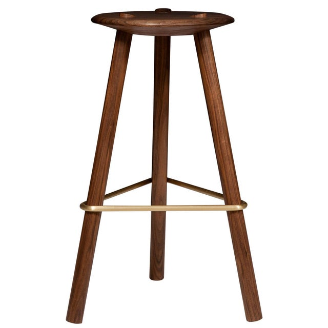 Solid select Walnut Tripod stool: (counter height or bar height) with satin brass stretcher. Designed by Ben Erickson for...