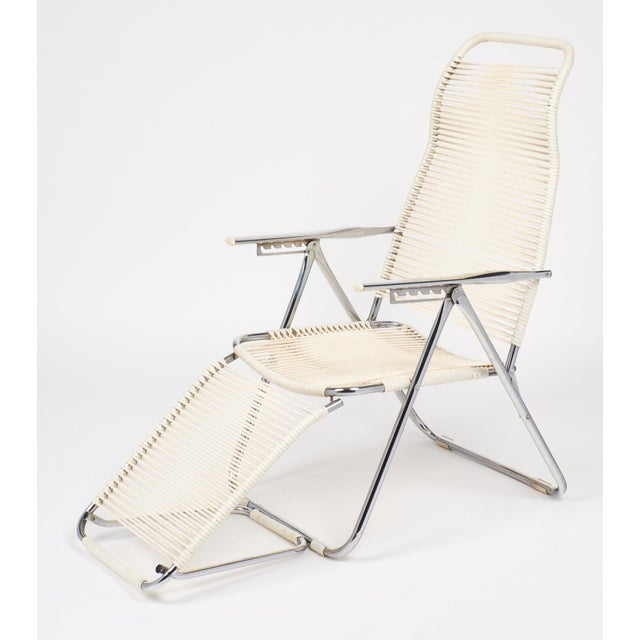 Iconic vintage adjustable chaises lounge chair from France with chromed steel frame. Very comfortable and versatile....