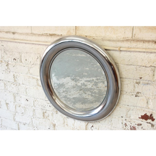 Offering a gorgeous mid-century modern round mirror produced in Italy by Reggiani. The mirror features a nice beveled edge...
