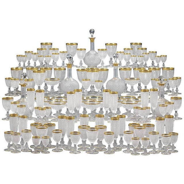 This superlative 128-piece cut crystal service is the work of the renowned house of Baccarat. Comprising glasses for red...