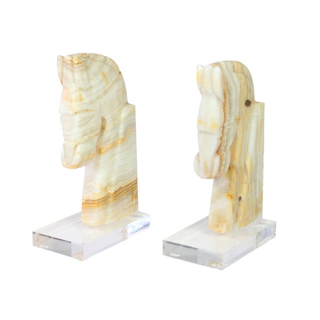 Solid hand-carved solid onyx Art Deco style horse heads have been modernized with lucite bases and originally bookends but...