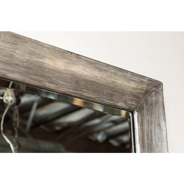 Paul Marra Distressed Silvered Framed Mirror. Wood-framed with a distressed smooth finish. The finish is smooth with...