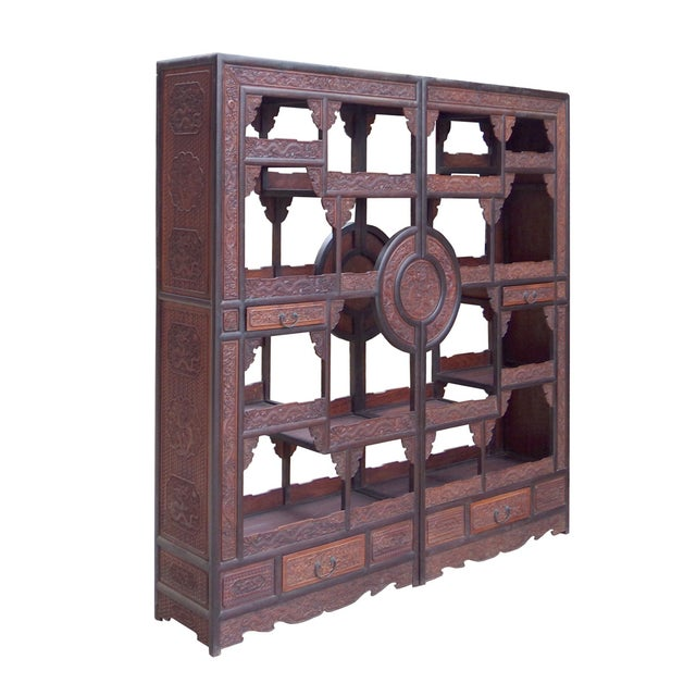 This is a display cabinet with different height and shape on each section for collection display. It can be placed against...