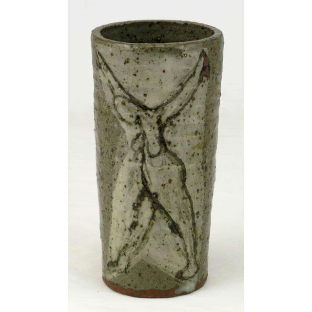 Very nice petite vase in hand thrown pottery with a variegated gray, glaze depicting nude and open armed women to each...