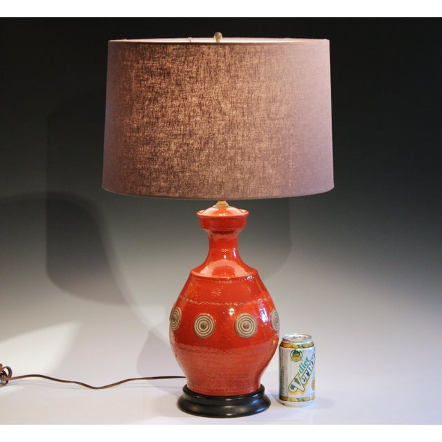 Vintage hand turned Neo-Classical Zaccagnini pottery lamp in fiery orange/red glaze with impressed and sprigged...