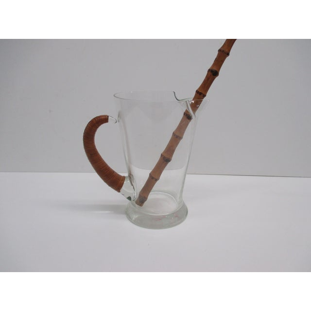 Vintage Italian Water Jug With Handle Covered in Rattan With Bamboo stirrer Italy, 1950's Size: 8 x 5 x 7.5