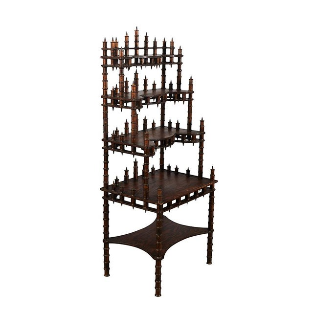 This whimsical folk art spool shelf has five stepped shelves with galleries of decorative spools.