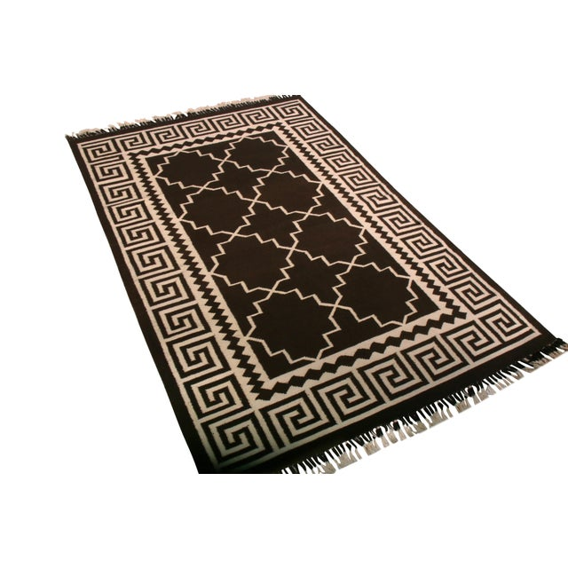 This hand-made Kilim represents the latest hand-woven contemporary flatweave rugs to join Rug & Kilim's titular...