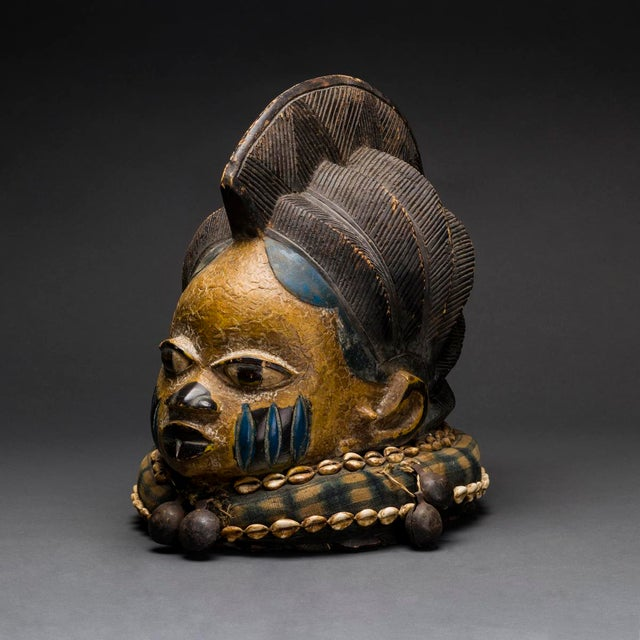 """This remarkable piece is an exceptional """"gelede"""" mask from the yoruba of nigeria. It is designed along traditional lines,..."""
