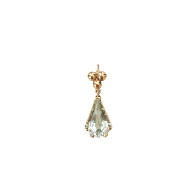 A wonderful pair of vintage 14K gold and faceted aquamarine pierced earrings. The stones are set in an elaborate openwork...