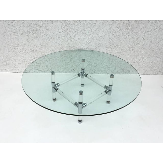 """An early acrylic and polished chrome with a 1/2"""" thick 48""""in diameter glass top Cocktail table designed by renowned..."""