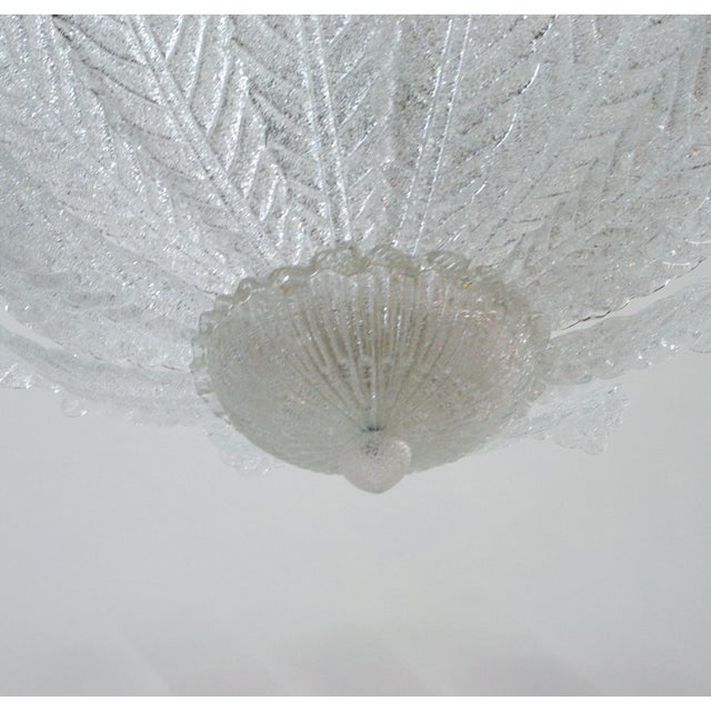 Italian flush mount with clear Murano glass leaves hand blown in Graniglia technique to produce a granular textured...