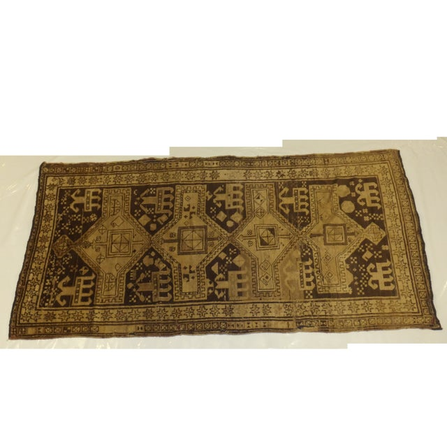 Add some elegance to your entryway or hall with this fine antique Akstafa runner rug from Russia. It has a plush wool...