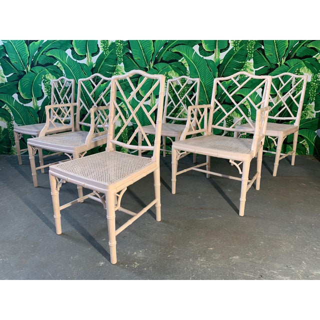 Set of 6 Chinoiserie style faux bamboo dining chairs with cane seats in the Asian chippendale style. Finished in a blush...