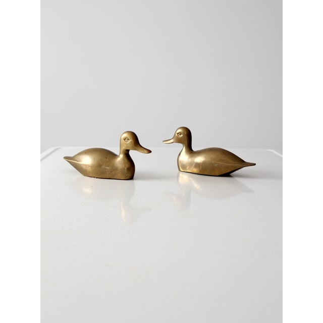 Offered is a pair of mid-century brass ducks. These friends feature modern sleek lines with a beautiful patina. They rest...