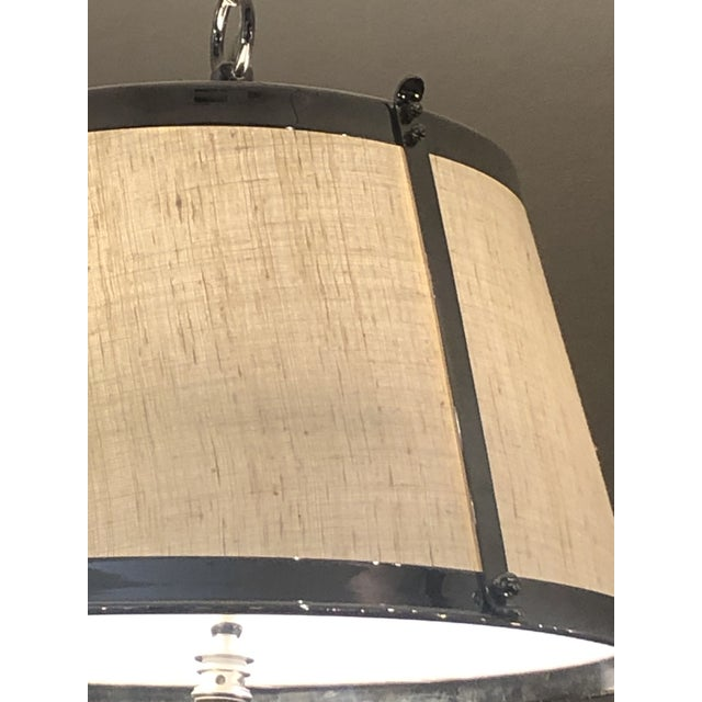 Handsome polished nickel and linen lamp shade shaped light fixture with matching ceiling cap.