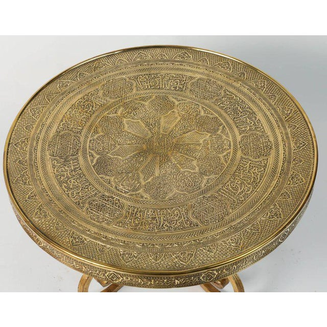 Middle Eastern Syrian antique brass repousse tray table with gilt iron stand. The embossed Art Deco style brass top is...