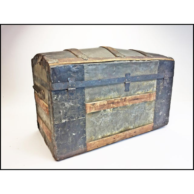 VINTAGE STEAMER CAMELBACK TRUNK. Made of wood with tin and steel. Reinforced corners and edges with wood bumper wrap....
