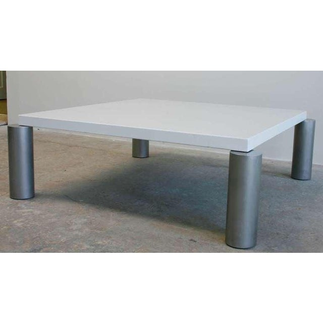 A Memphis style steel frame enameled top coffee table with solid aluminum legs.