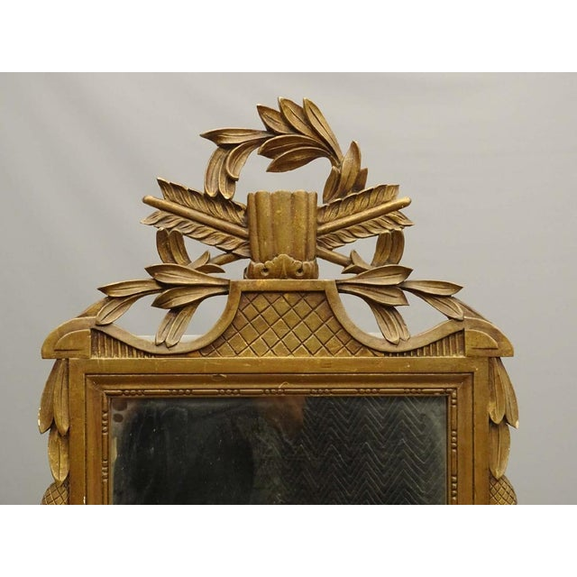 Decorative carved wood mirror with gold finish, great patina, no missing pieces-with arrow, wreath and tassel motif.