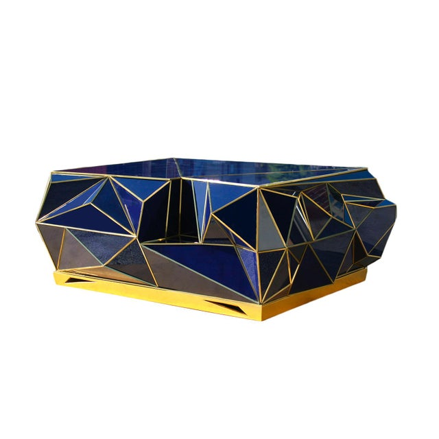 This one of a kind piece is our biggest pride and joy. Made in cobalt blue glass and bronze inserts. The base is gilded in...