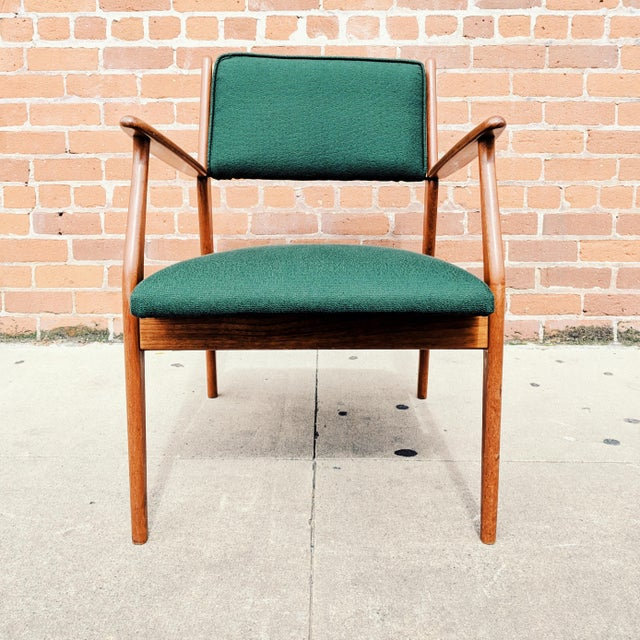 1960s Danish Modern teak lounge chair with new foam and upholstery, similar in style to pieces from Jens Risom. In...