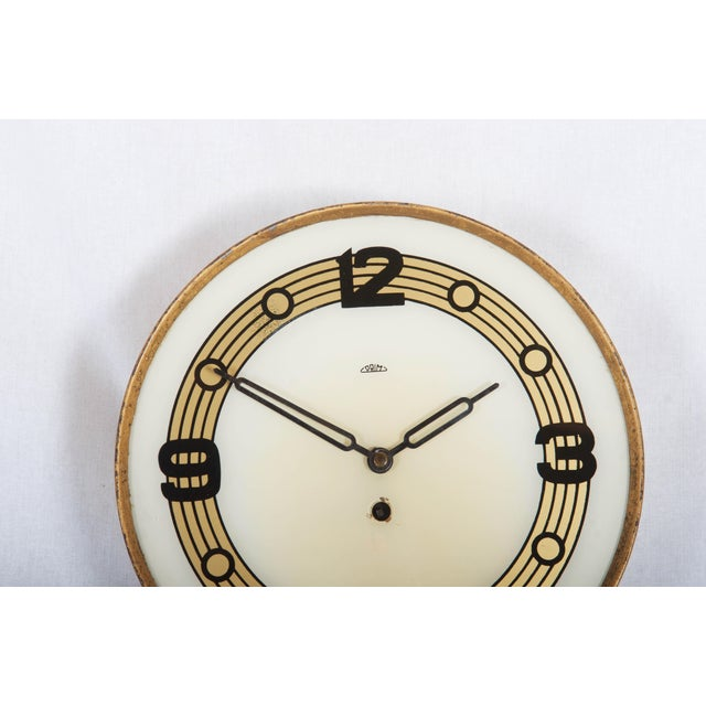 Wood frame with glass clock face originally with mechanical movement now rebuild to a battery one. Original condition with...