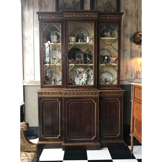 Gilt decorated bookcase. Made in the mid 19th century.