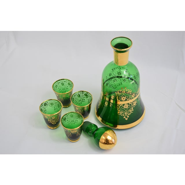 A stunning emerald green Italian decanter with four matching liqueur glasses. The detail on this item is spectacular with...