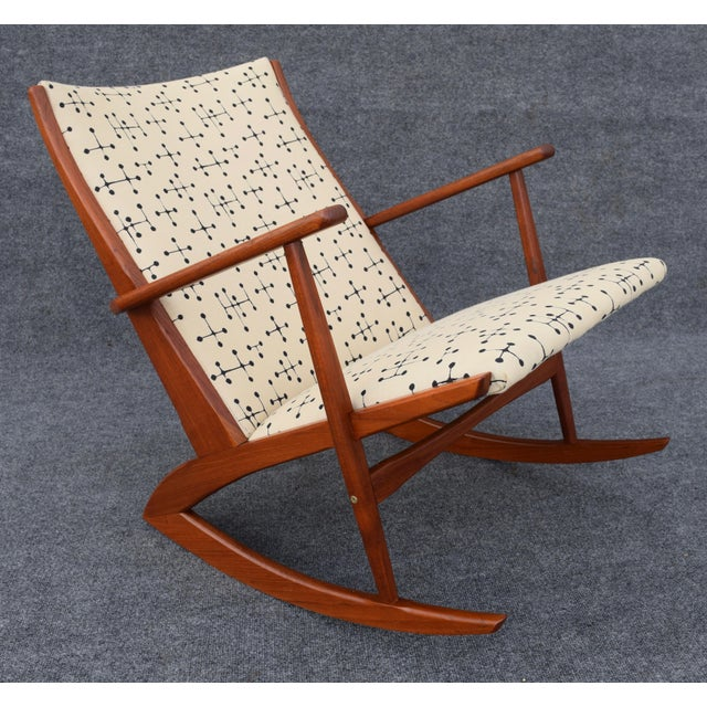 Here is a incredible and now unique Scandinavian teak rocking chair Model No.97 designed by Georg Jensen in 1962 and...