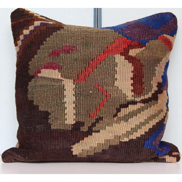 """This vintage kilim pillow cover is 16"""" x 16""""and hand-woven along the Mediterranean coastal region of Turkey. This handmade..."""