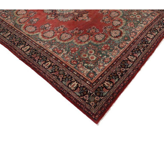 This early 20th century antique Persian Mahal rug with traditional style features a highly decorative center medallion in...