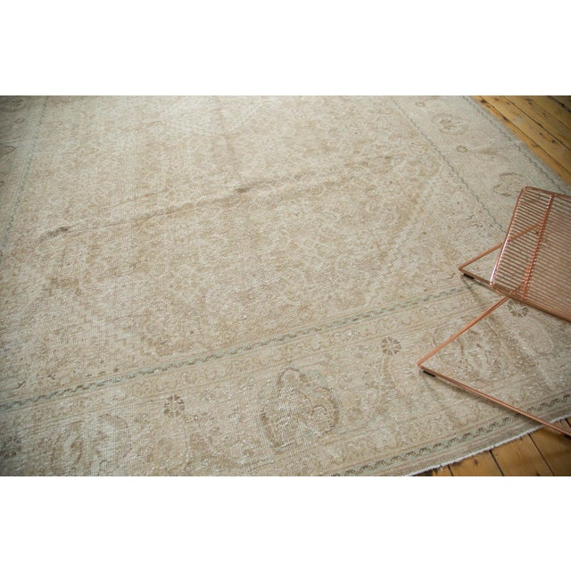 :: Diminutive center medallion with stepped contour atop a covered field in an allover Herati motif. Main border comprised...