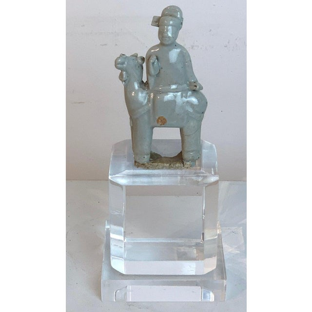 Song dynasty Chinese celadon porcelain horse and rider on later Lucite pedestal Chinese celadon porcelain horse and rider,...