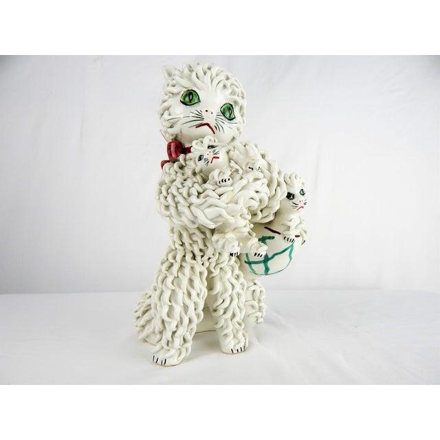 "Charming 1950s Italian ceramic Spaghetti Cat holding 3 kittens figure. Signed ""Italy"" on base."
