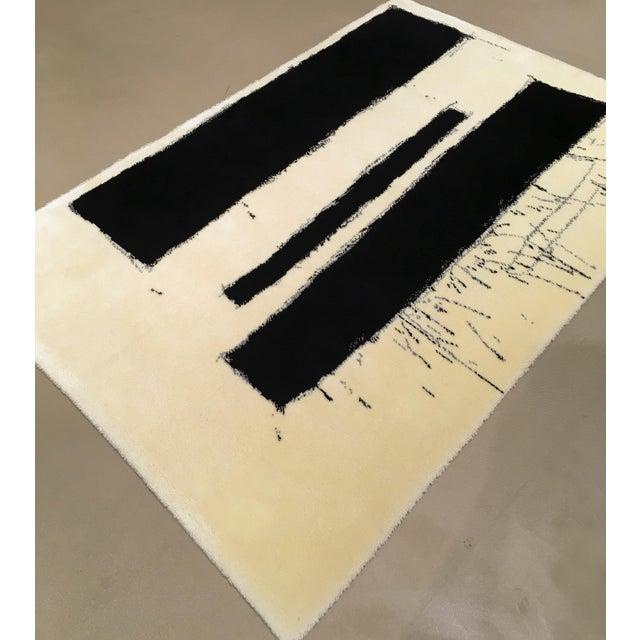"An Axminster Ege wool rug designed by Danish artist Preben Hornung, 1919-1989, circa 1970. Entitled ""Monument"", this..."