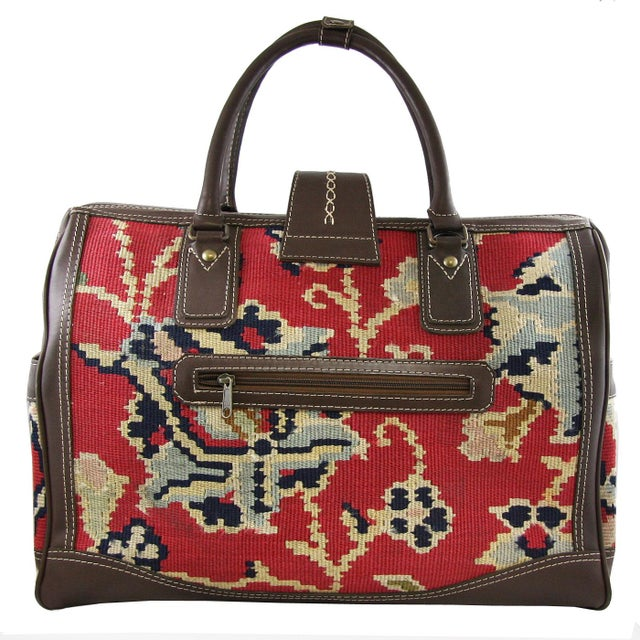 Mary Poppins' famous carpet bag was obviously the inspiration for this lovely Vintage Kilim Carpet bag. We're not positive...